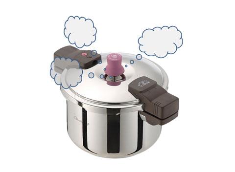 蒸気が出ている圧力釜