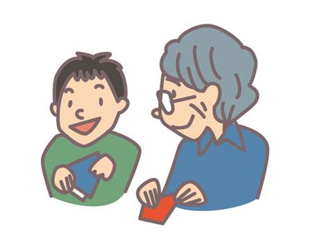 子供と話をしている老人