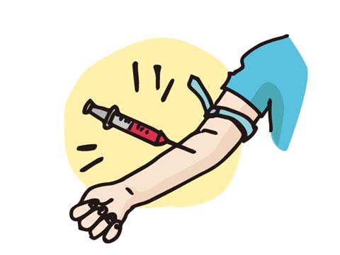 血液検査の為に採血している人
